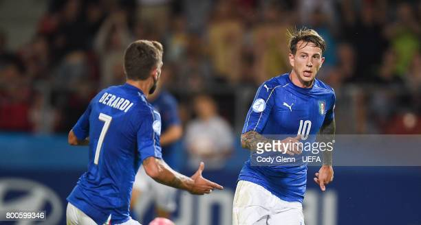 Federico Bernardeschi of Italy celebrates with teamate Domenico Berardi after scoring his side's first goal during their UEFA European Under21...
