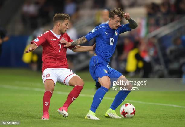 Federico Bernardeschi of Italy controls the ball under pressure of Andrew Hjulsager of Denmark during the UEFA European Under21 Championship Group C...