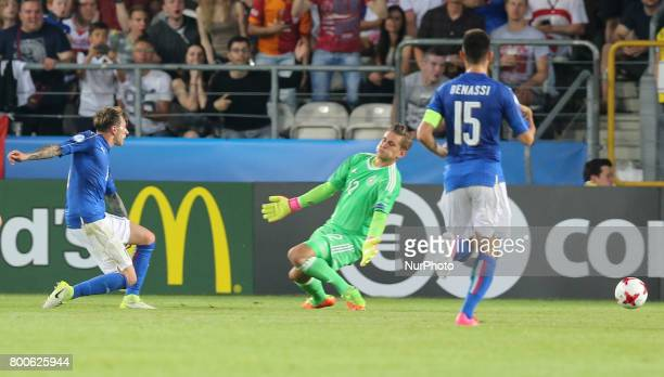 Federico Bernardeschi of Italy shoots to score his side's first goal during their UEFA European Under21 Championship 2017 match against Germany on...