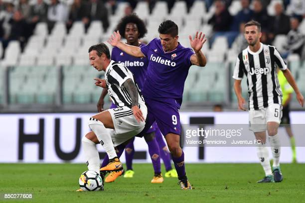 Federico Bernardeschi of Juventus and Giovanni Simeone of fiorentina compete for the ball during the Serie A match between Juventus and ACF...