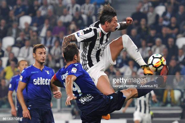 Federico Bernardeschi of Juventus and Senad Lulic of Lazio compete for the ball during the Serie A match between Juventus and SS Lazio on October 14...