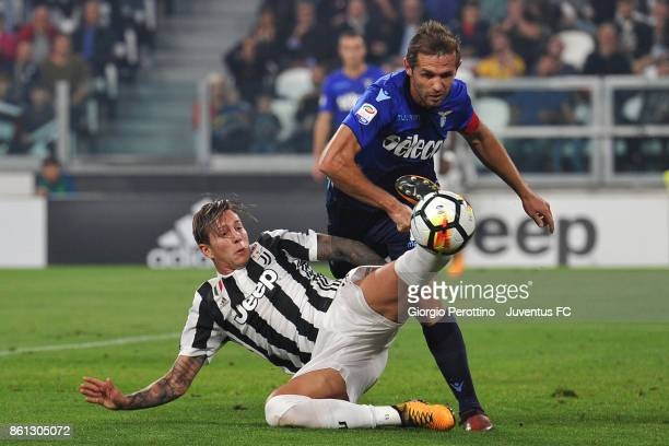 Federico Bernardeschi of Juventus and Senad Lulic of Lazio competes for the ball during the Serie A match between Juventus and SS Lazio on October 14...