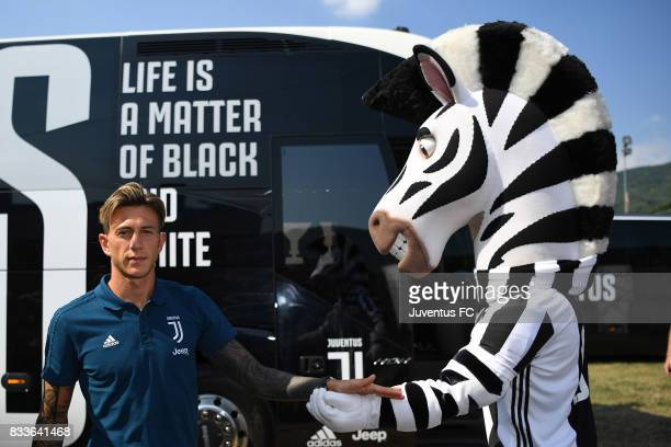 Federico Bernardeschi of Juventus cheers club Mascot jay before the preseason friendly match between Juventus A and Juventus B on August 17 2017 in...