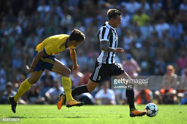 Federico Bernardeschi of Juventus runs with the ball during the preseason friendly match between Juventus A and Juventus B on August 17 2017 in...