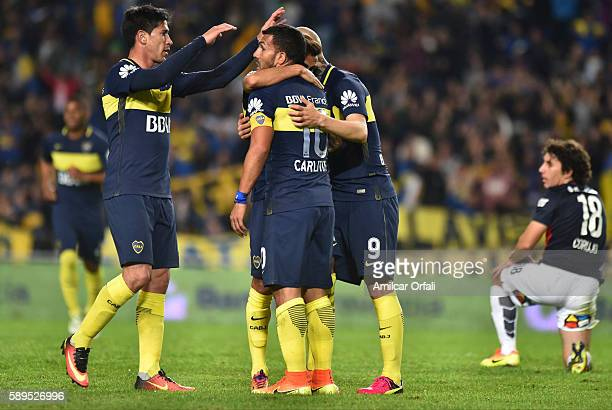 Federico Carrizo of Boca Juniors celebrates with teammates after scoring the first goal of his team during a friendly match between Boca Juniors and...