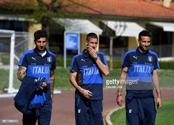 Federico Ceccherini Diego Falcinelli and Gian Marco Ferrari of Italy chat prior to the training session at the club's training ground at Coverciano...