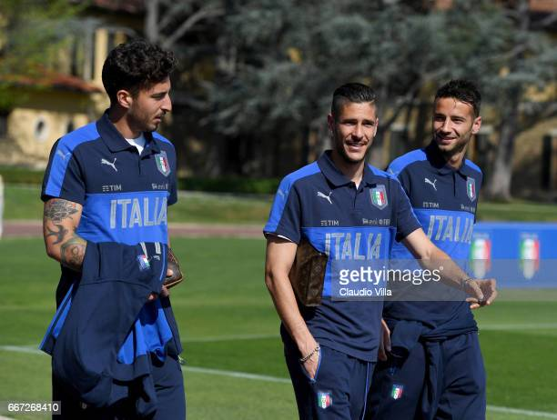 Federico Ceccherini Diego Falcinelli Gian Marco Ferrari of Italy chat prior to the training session at the club's training ground at Coverciano on...