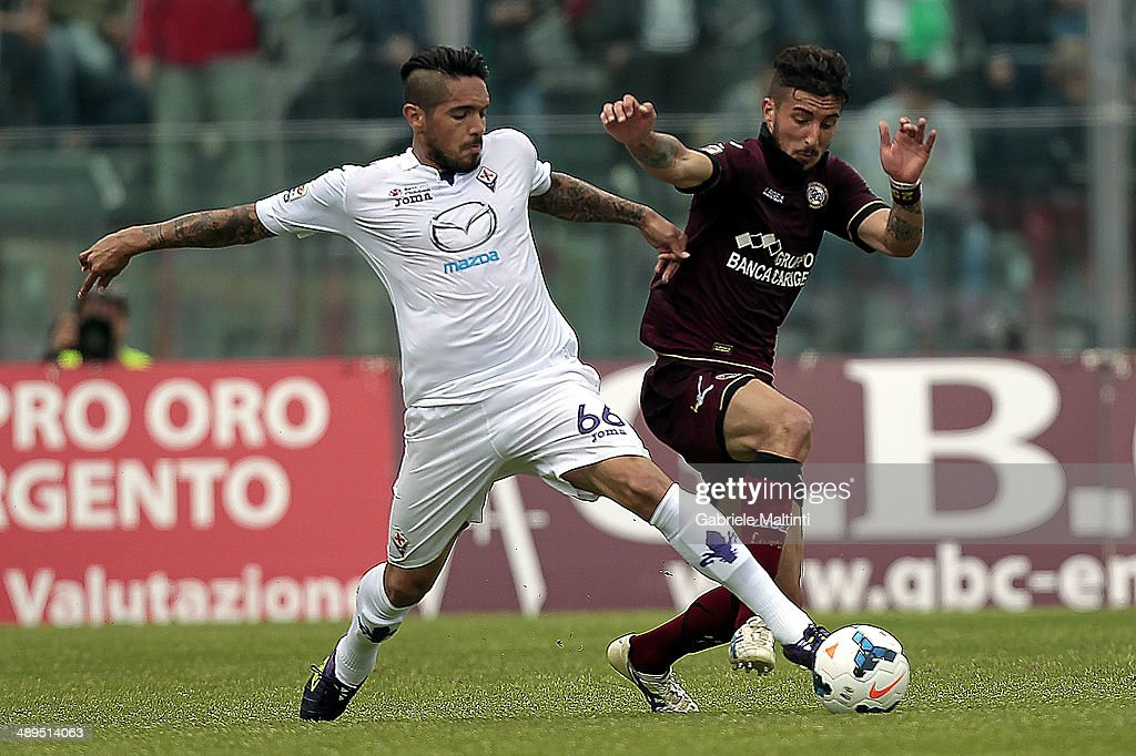 Federico Ceccherini of AS Livorno Calcio fights for the ball with Juan Manuel Vargas of ACF Fiorentina during the Serie A match between AS Livorno Calcio and ACF Fiorentina at Stadio Armando Picchi on May 11, 2014 in Livorno, Italy.