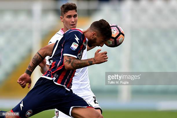Federico Ceccherini of Crotone and Roland Sallai of Palermo compete for the ball during the Serie A match between FC Crotone and US Citta di Palermo...