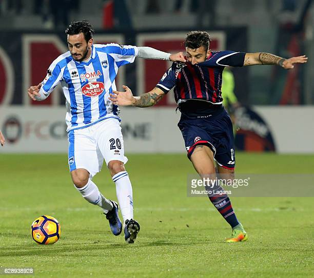 Federico Ceccherini of Crotone competes for the ball with Alberto Aquilani of Pescara during the Serie A match between FC Crotone and Pescara Calcio...