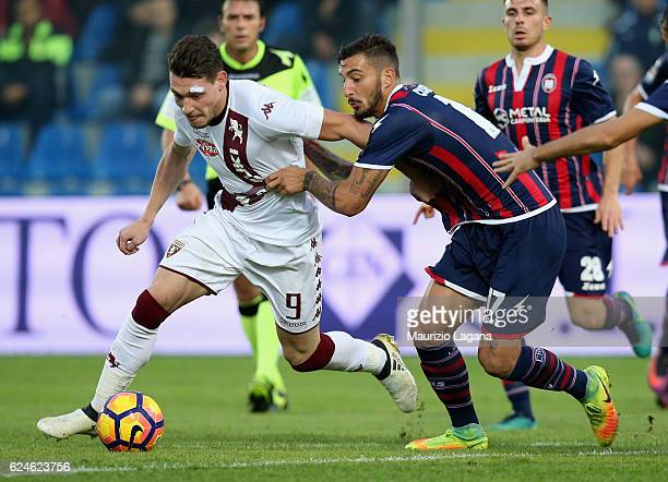 Federico Ceccherini of Crotone competes for the ball with Andrea Belotti of Torino during the Serie A match between FC Crotone and FC Torino at...