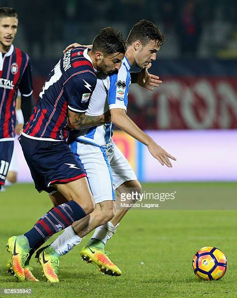 Federico Ceccherini of Crotone competes for the ball with Gianluca Caprari of Pescara during the Serie A match between FC Crotone and Pescara Calcio...