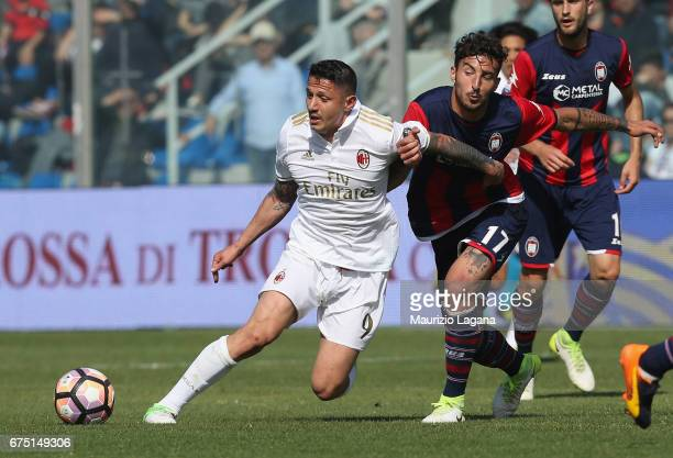 Federico Ceccherini of Crotone competes for the ball with Gianluca Lapadula of Milan during the Serie A match between FC Crotone and AC Milan at...