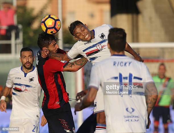 Federico Ceccherini of Crotone competes for the ball with Luis Muriel Sampdoria during the Serie A match between FC Crotone and UC Sampdoria at...