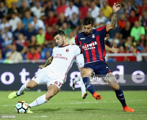 Federico Ceccherini of Crotone competes for the ball with Patrick Cutrone of Milan during the Serie A match between FC Crotone and AC Milan on August...