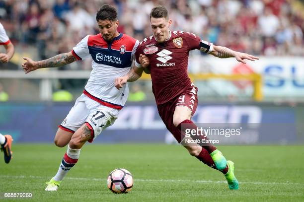 Federico Ceccherini of FC Crotone and Andrea Belotti of Torino FC compete for the ball during the Serie A football match between Torino FC and FC...