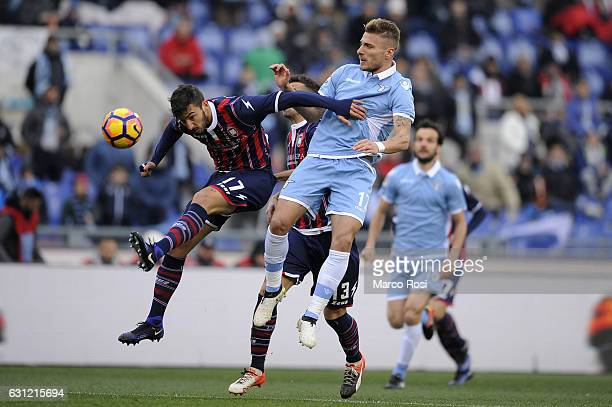 Federico Ceccherini of FC Crotone compete for the ball with Ciro Immobile of SS Lazio during the Serie A match between SS Lazio and FC Crotone at...