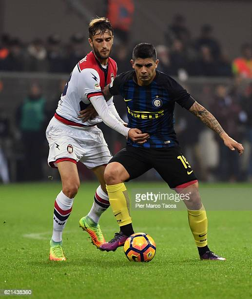 Federico Ceccherini of FC Crotone competes for the ball with Ever Banega of FC Internazionale during the Serie A match between FC Internazionale and...