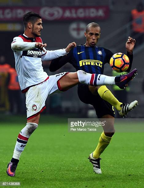 Federico Ceccherini of FC Crotone competes for the ball with Joao Miranda of FC Internazionale during the Serie A match between FC Internazionale and...
