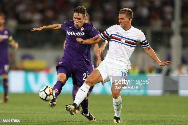 Federico Chiesa of ACF Fiorentina battles for the ball with Dennis Praet of UC Sampdoria during the Serie A match between ACF Fiorentina and UC...