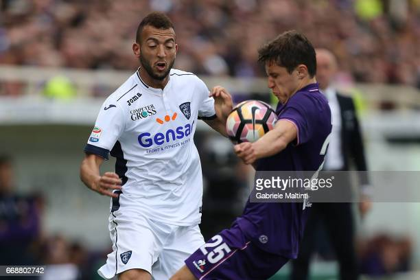 Federico Chiesa of ACF Fiorentina battles for the ball with Omar El Kaddouri of Empoli FC during the Serie A match between ACF Fiorentina and Empoli...