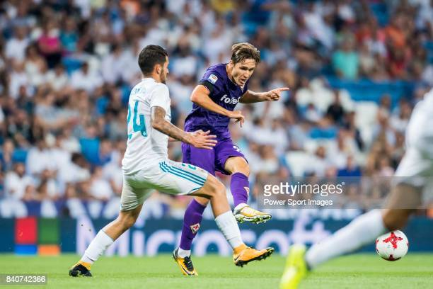 Federico Chiesa of ACF Fiorentina fights for the ball with Daniel Ceballos Fernandez Dani Ceballos of Real Madrid during the Santiago Bernabeu Trophy...