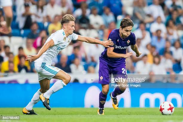 Federico Chiesa of ACF Fiorentina fights for the ball with Marcos Llorente of Real Madrid during the Santiago Bernabeu Trophy 2017 match between Real...