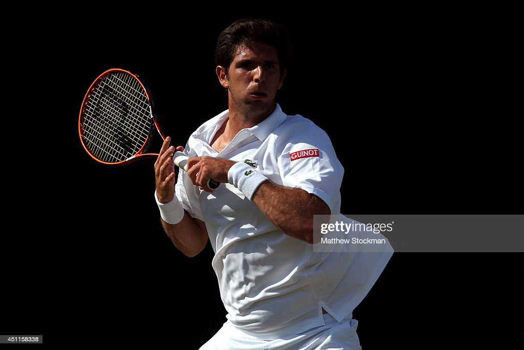 <a gi-track='captionPersonalityLinkClicked' href=/galleries/search?phrase=Federico+Delbonis&family=editorial&specificpeople=8904860 ng-click='$event.stopPropagation()'>Federico Delbonis</a> of Argentina in action during his Gentlemen's Singles first round match against Jarkko Nieminen of Finland on day two of the Wimbledon Lawn Tennis Championships at the All England Lawn Tennis and Croquet Club at Wimbledon on June 24, 2014 in London, England.