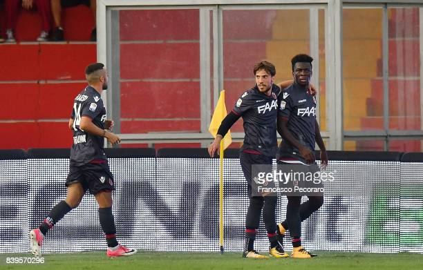 Federico Di Francesco Godfred Donsah and Simone Verdi of Bologna FC celebrate the 01 goal scored by Godfred Donsah during the Serie A match between...