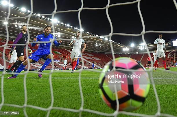 Federico Di Francesco of Italy celebrates as a deflected own goal from Brendan Galloway of England loops over goalkeeper Angus Gunn into the England...