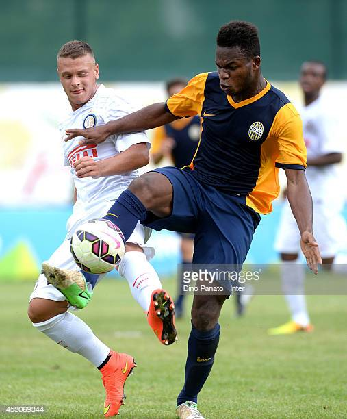 Federico Dimarco of Internazionale battles for the ball with Francis Boateng of Verona during a Trentino Juvenile Cup match between FC Internazionale...