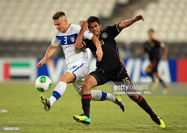 Federico DiMarco of Italy battles with Christian Tovar of Mexico during the FIFA U17 World Cup UAE 2013 Round of 16 match between Italy and Mexico at...