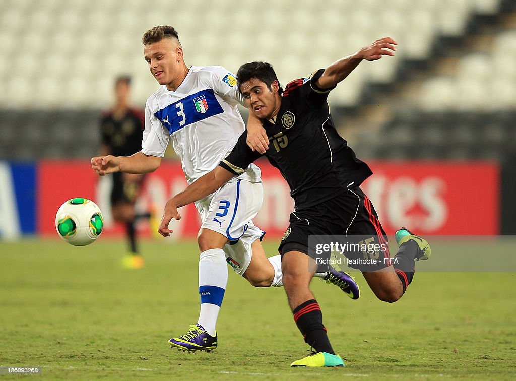 Federico DiMarco of Italy battles with Christian Tovar of Mexico during the FIFA U-17 World Cup UAE 2013 Round of 16 match between Italy and Mexico at the Mohamed Bin Zayed Stadium on October 28, 2013 in Abu Dhabi, United Arab Emirates.