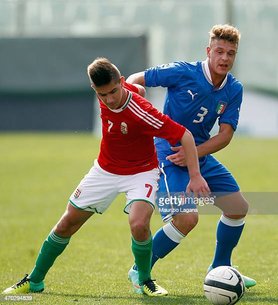 Federico Dimarco of Italy competes for the ball with Alex Dimasdi of Hungary during the international friendly match between Italy U17 and Hungary...