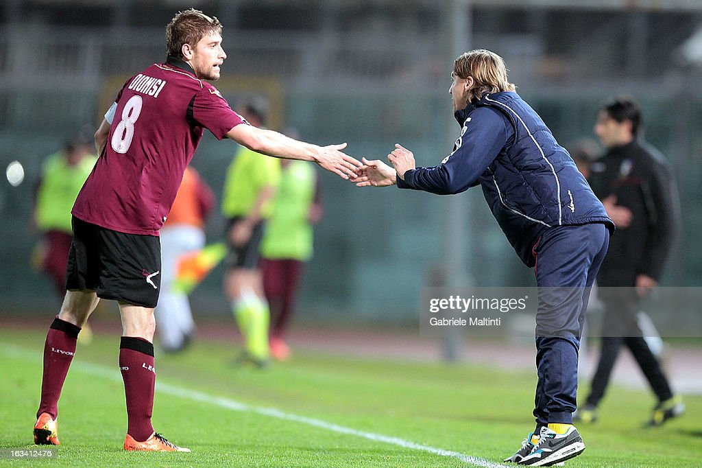 Federico Dionisi of AS Livorno celebrates the goal with head coach Nicola Davide during the Serie B match between AS Livorno and Reggina Calcio at Stadio Armando Picchi on March 9, 2013 in Livorno, Italy.