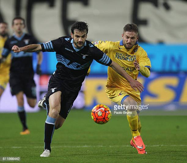 Federico Dionisi of Frosinone Calcio competes for the ball with Marco Parolo of SS Lazio during the Serie A match between Frosinone Calcio and SS...