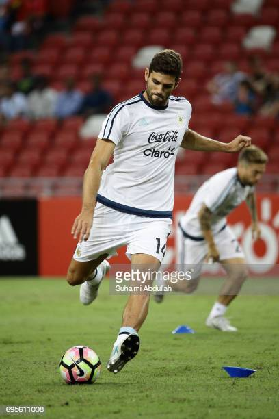 Federico Fazio of Argentina warms up before the International Test match between Argentina and Singapore at National Stadium on June 13 2017 in...