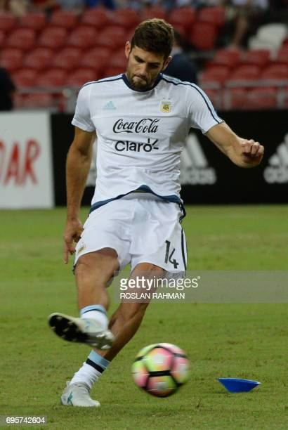 Federico Fazio of Argentina warms up before the start of their international friendly football match against Singapore at the National Stadium in...