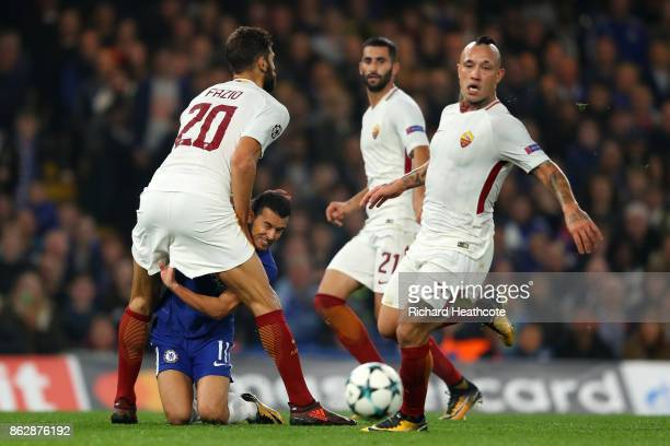 Federico Fazio of AS Roma and Pedro of Chelsea colide during the UEFA Champions League group C match between Chelsea FC and AS Roma at Stamford...
