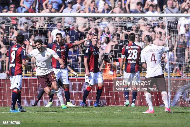 Federico Fazio of AS Roma celebrates after scoring the oopening goal during the Serie A match between Bologna FC and AS Roma at Stadio Renato...