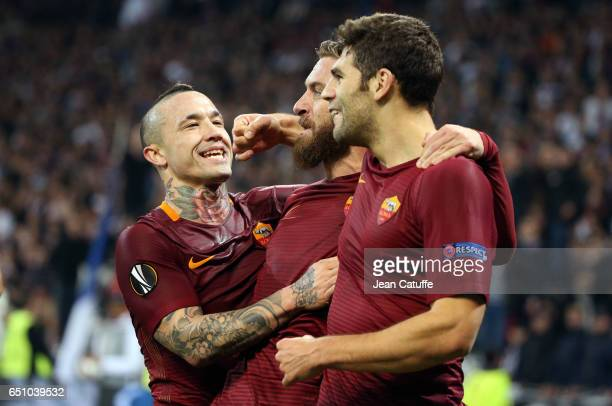 Federico Fazio of AS Roma celebrates his goal with Radja Nainggolan and Daniele de Rossi of AS Roma during the UEFA Europa League Round of 16 first...