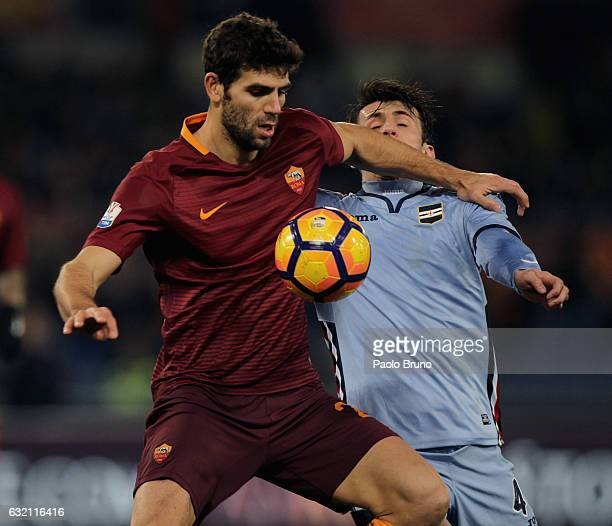 Federico Fazio of AS Roma competes for the ball with Ante Budimir of UC Sampdoria during the TIM Cup match between AS Roma and UC Sampdoria at Stadio...