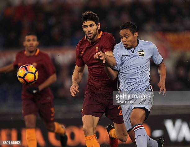 Federico Fazio of AS Roma competes for the ball with Luis Muriel of UC Sampdoria during the TIM Cup match between AS Roma and UC Sampdoria at Stadio...