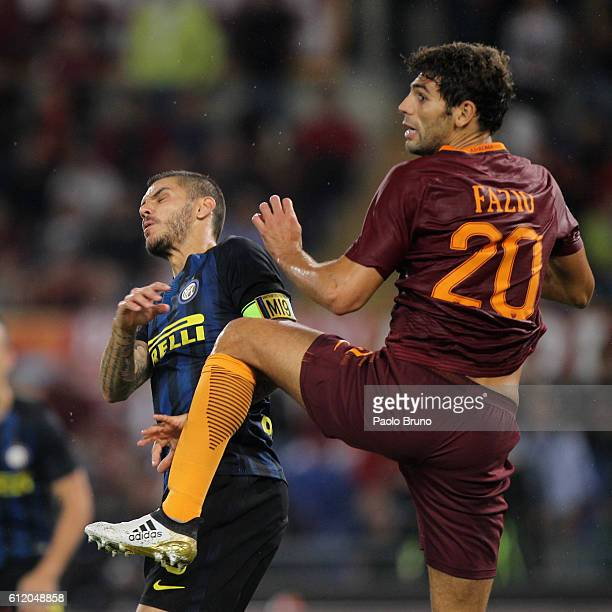 Federico Fazio of AS Roma competes with Mauro Icardi of FC Internazionale during the Serie A match between AS Roma and FC Internazionale at Stadio...