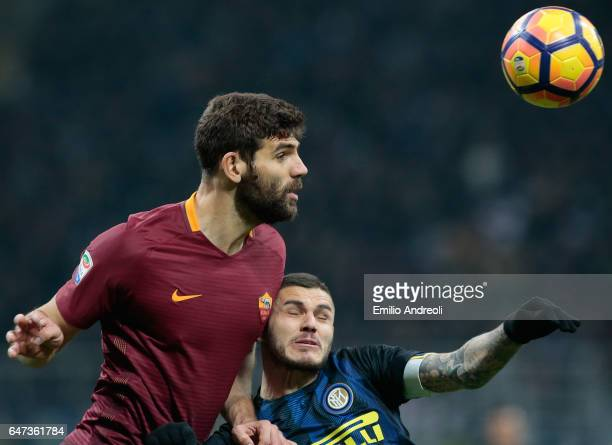Federico Fazio of AS Roma jumps for the ball against Mauro Emanuel Icardi of FC Internazionale Milano during the Serie A match between FC...