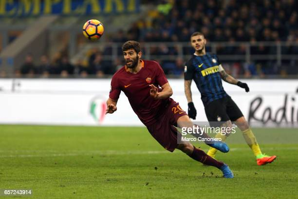Federico Fazio of AS Roma jumps for the ball with Mauro Emanuel Icardi of FC Internazionale Milano during the Serie A match between FC Internazionale...
