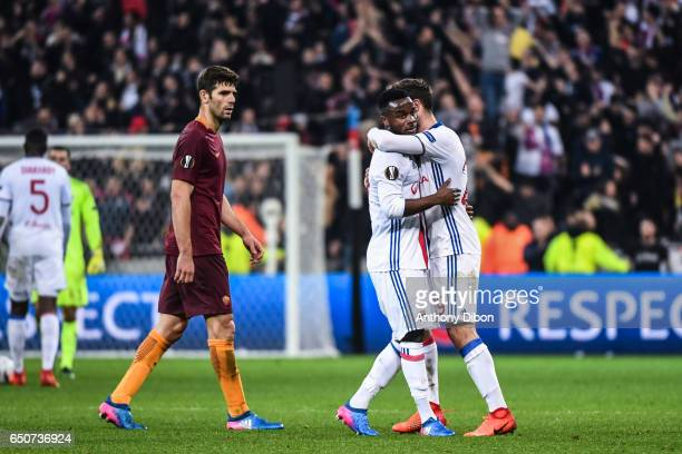 Federico Fazio of As ROma looks dejected while Maxwel Cornet of Lyon celebrates the victory during the Uefa Europa League Round of 16 first leg match...