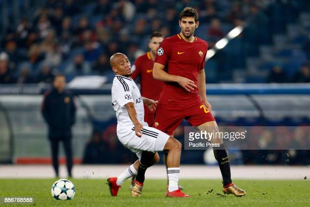 Federico Fazio of Roma fights for the ball with Dino Ndlovu of Qarabag during the UEFA Champions League Group C soccer match in Rome Roma won the...