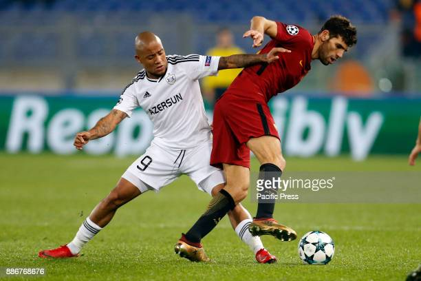 Federico Fazio of Roma is tackled by Dino Ndlovu of Qarabag during their UEFA Champions League Group C soccer match in Rome Roma won the match 10