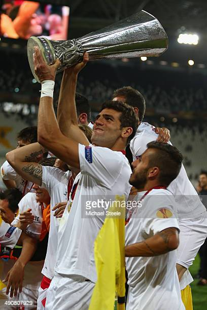 Federico Fazio of Sevilla FC lifts the winners trophy after his sides penalty shoot out victory during the UEFA Europa League Final between Sevilla...